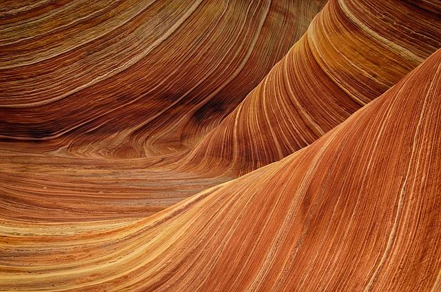 Uneven lines in sandstone.