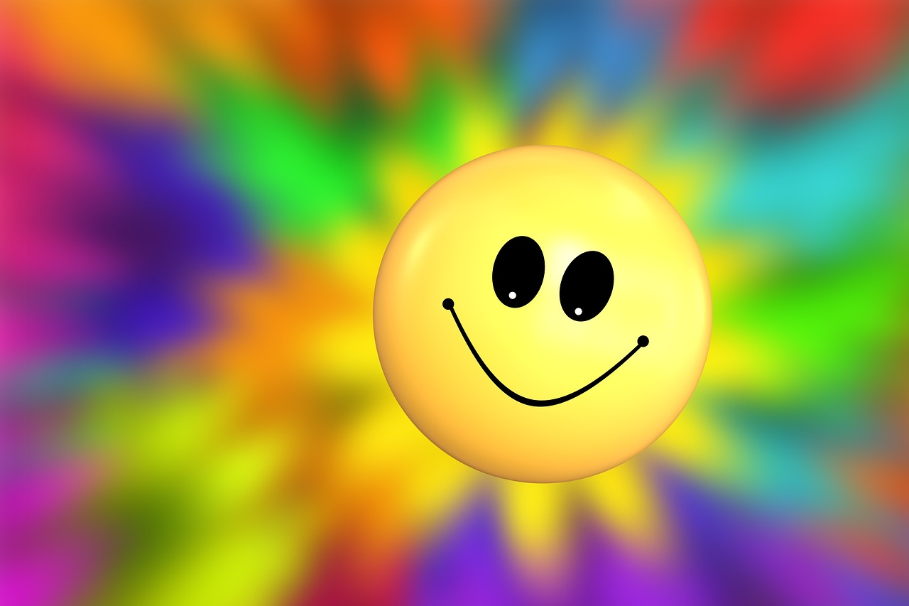 For inspirational stories: Humor, Joy, Yellow Happy Face with background of bright colors.