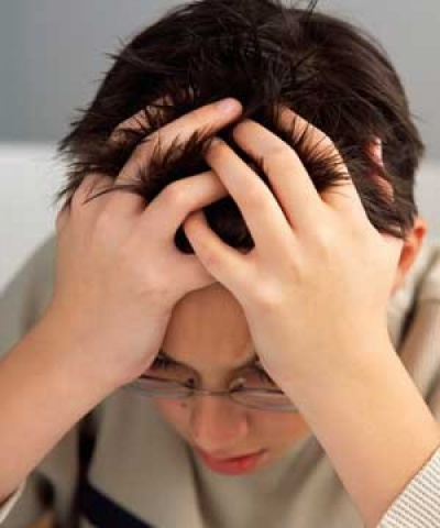 Color photo of young boy with hands in his hair, showing fvrustration.Design with this script: Success and Recognition Are Essential Ingredients for Self-confidence