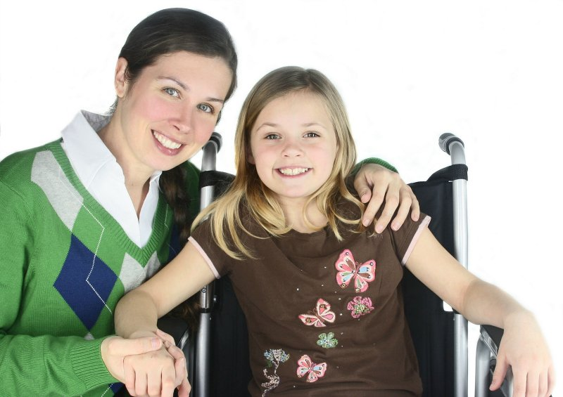 Mother with daughter in wheelchair