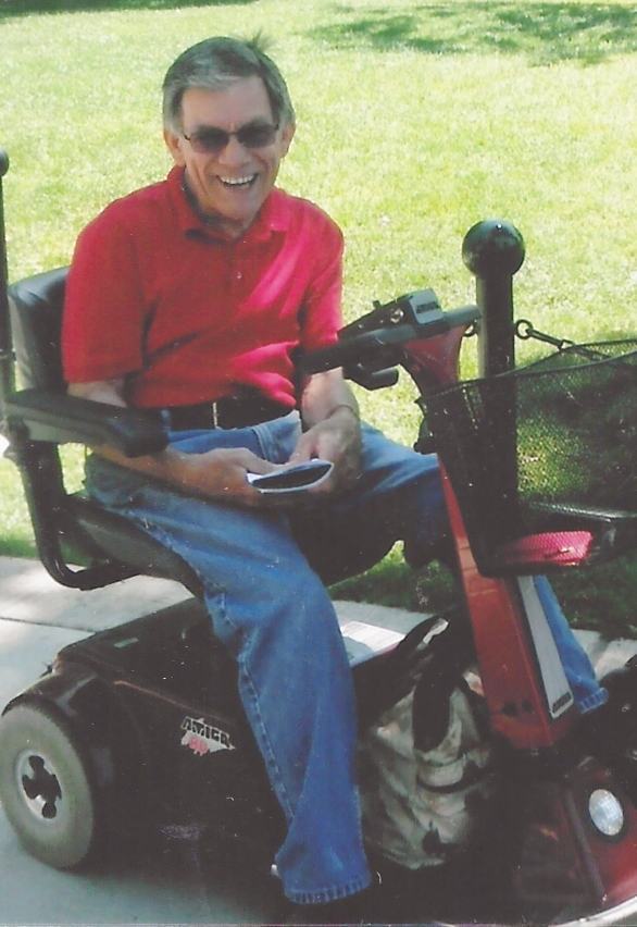 Jim Hasse sits in his Amigo electric scooter in 2012.