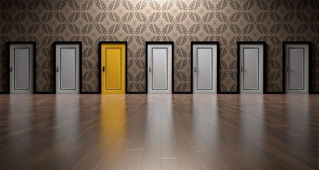 Six white doors and one yellow door: Open the right door.