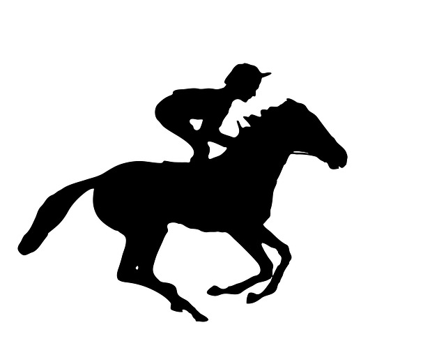 Black and white silhouette of man riding galloping race horse.