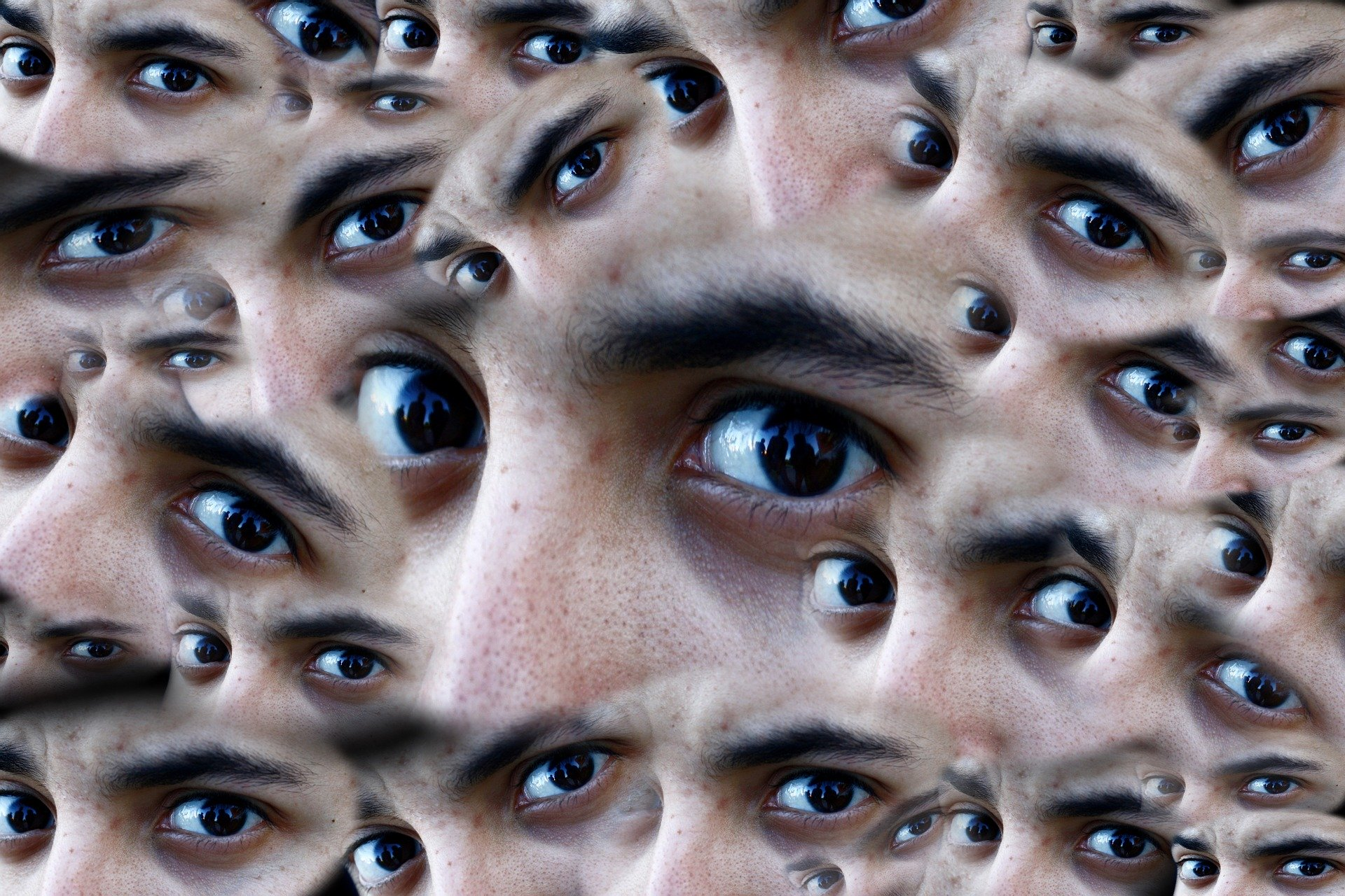 Montage of a man's eyes (tight shot) from various angles.