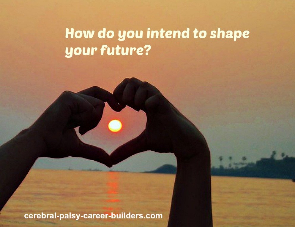 Heart shaped by fingers of both hands set against a sunset, representing