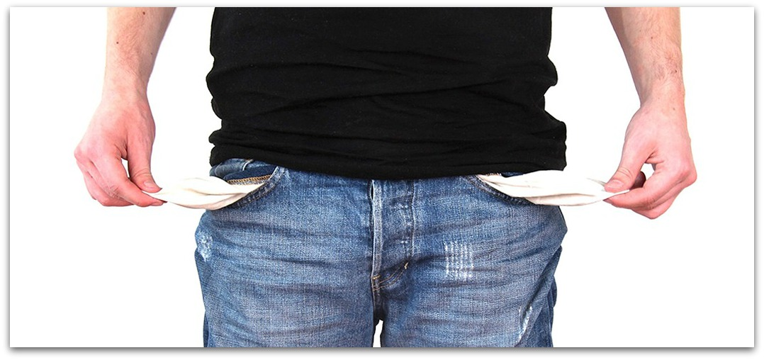 Photo of man showing nothing in his jeans pockets.